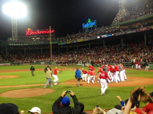 The team waits for Jonny Gomes after his winning homer against Tampa